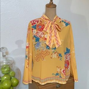 Yellow floral long sleeved blouse.